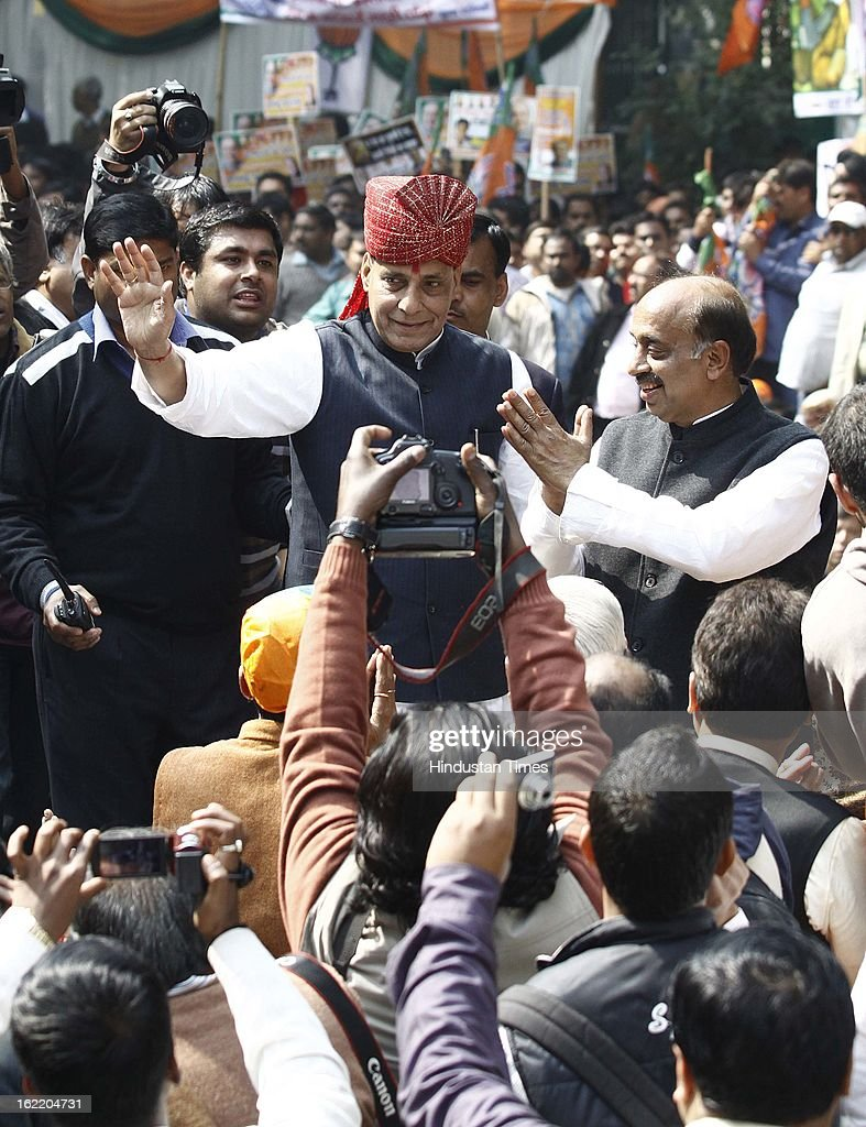 BJP National President Rajnath Singh with newly appointed Delhi BJP chief Vijay Goel greets the supporters at a rally in protest against Union Home Minister Sushil Kumar Shinde's remarks linking saffron terror to BJP and RSS, at Jantar Mantar on February 20, 2013 in New Delhi, India. Stepping up the attack on Shinde ahead of the Budget session the BJP president said that the comments were part of a conspiracy to divide the nation for votebank politics and demanded an apology from Home Minister.