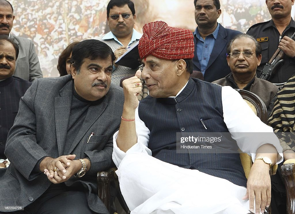 BJP National President Rajnath Singh with Nitin Gadkari during a rally in protest against Union Home Minister Sushil Kumar Shinde's remarks linking saffron terror to BJP and RSS, at Jantar Mantar on February 20, 2013 in New Delhi, India. Stepping up the attack on Shinde ahead of the Budget session the BJP president said that the comments were part of a conspiracy to divide the nation for votebank politics and demanded an apology from Home Minister.