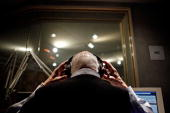 National Public Radio's Carl Kasell puts on his headphones before delivering one of his last newscasts during the Morning Edition program at NPR...