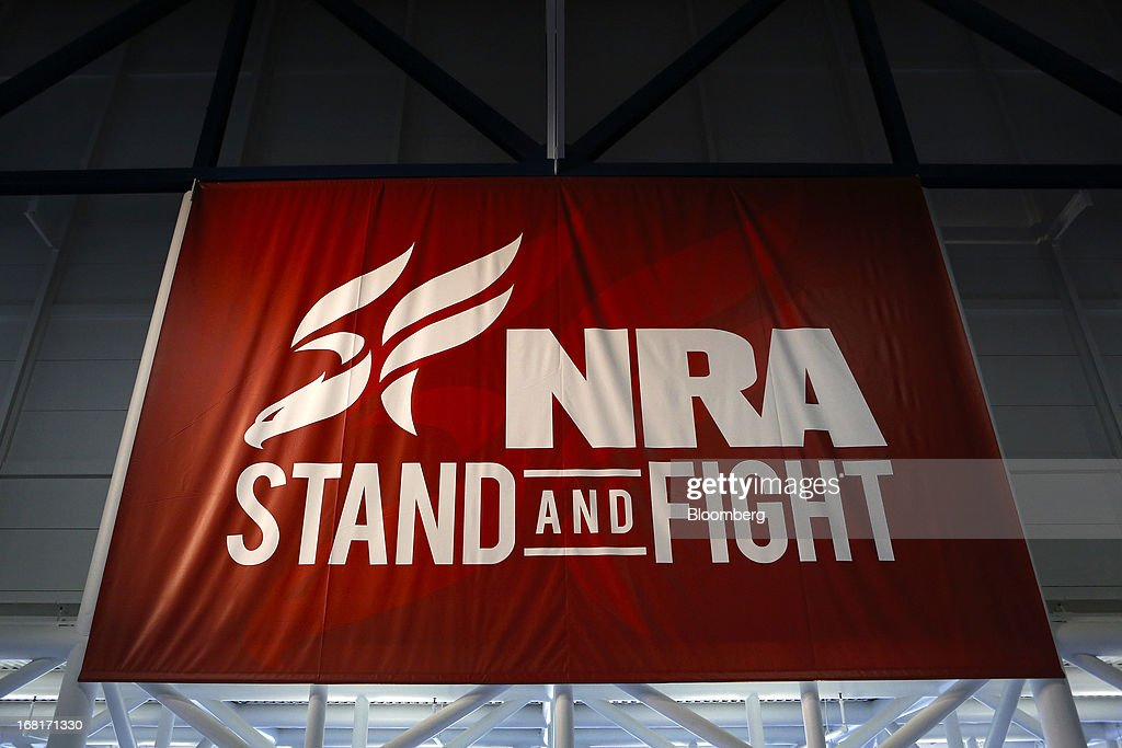 A National Rifle Association (NRA) banner is displayed during the organization's Annual Meetings & Exhibits at the George R. Brown Convention Center in Houston, Texas, U.S., on Saturday, May 4, 2013. After the U.S. Senate defeated a proposed expansion of background checks on gun purchases, the NRA's annual conference has a celebratory atmosphere. Yet as the festivities began, gun-control advocates swarmed town halls, organizing petitions and buying local ads to pressure senators from Alaska to New Hampshire to reconsider the measure that failed by six votes on April 17. Photographer: Aaron M. Sprecher/Bloomberg via Getty Images
