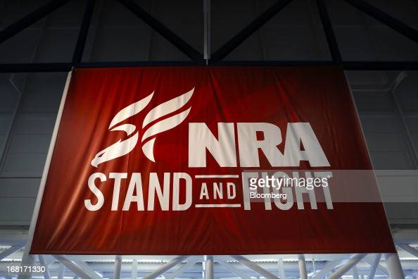 A National Rifle Association banner is displayed during the organization's Annual Meetings Exhibits at the George R Brown Convention Center in...