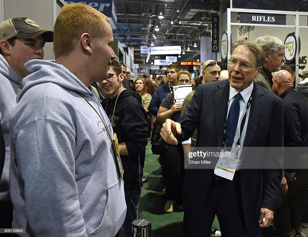 National Rifle Association Executive Vice President <a gi-track='captionPersonalityLinkClicked' href=/galleries/search?phrase=Wayne+LaPierre&family=editorial&specificpeople=2488494 ng-click='$event.stopPropagation()'>Wayne LaPierre</a> (R) greets attendees as he tours the 2016 National Shooting Sports Foundation's Shooting, Hunting, Outdoor Trade (SHOT) Show at the Sands Expo and Convention Center on January 19, 2016 in Las Vegas, Nevada. The SHOT Show, the world's largest annual trade show for shooting, hunting and law enforcement professionals, runs through January 23 and is expected to feature 1,600 exhibitors showing off their latest products and services to more than 62,000 attendees.