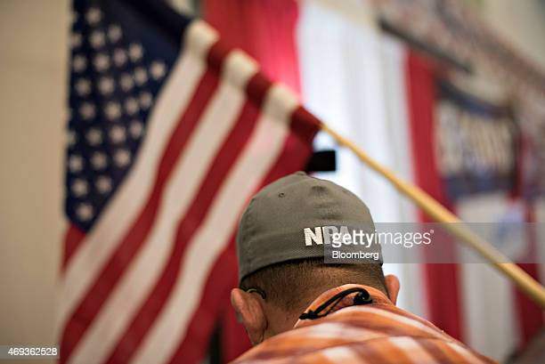 A National Rifle Association logo appears on the hat of a shooting instructor at an air gun range during the 144th NRA Annual Meetings and Exhibits...