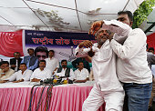 National Samata Party ticket aspirant Ashok Gupta reacts as he demands for ticket for assembly elections during the press conference to announce the...