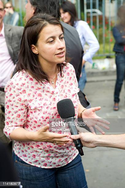National Secretary of french ecologist party 'Europe Ecologie Les Verts' Cecile Duflot is interviewed by the medias as she attends the party...