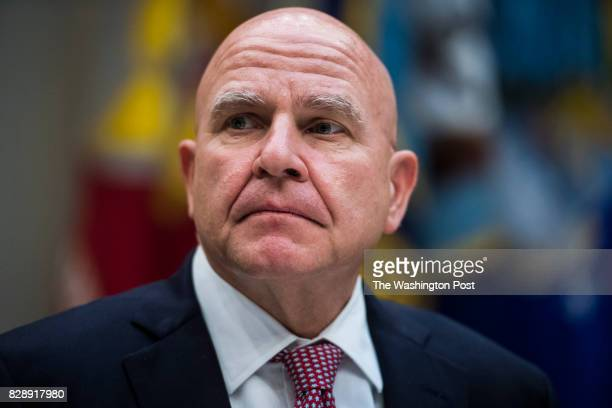National Security Adviser HR McMaster listens as President Donald Trump speaks to reporters and members of the media during a lunch with services...