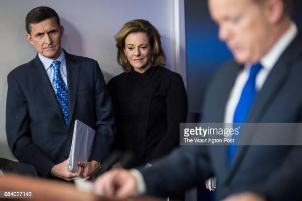 National Security Adviser Michael Flynn left and KT McFarland deputy national security adviser center listen as White House press secretary Sean...