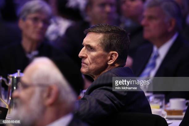 National Security Adviser Michael Flynn listens to remarks at the National Prayer Breakfast where US President Donald Trump spoke February 2 2017 in...