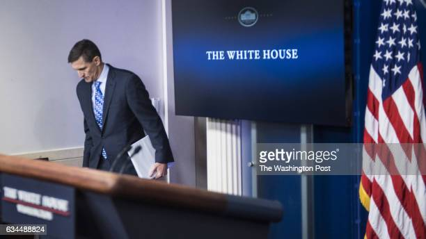 National Security Adviser Michael Flynn walks in to the James S Brady Press Briefing Room during the daily news briefing at the White House in...