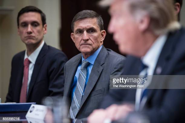 National Security Adviser Mike Flynn listens to President Trump during a listening session with cyber security experts in the Roosevelt Room the...