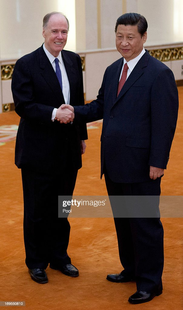 U.S. National Security Adviser Tom Donilon (L) and Chinese President Xi Jinping, (R) shake hands before their meeting at the Great Hall of the People in Beijing, China, Monday, May 27, 2013 in Beijing, China.
