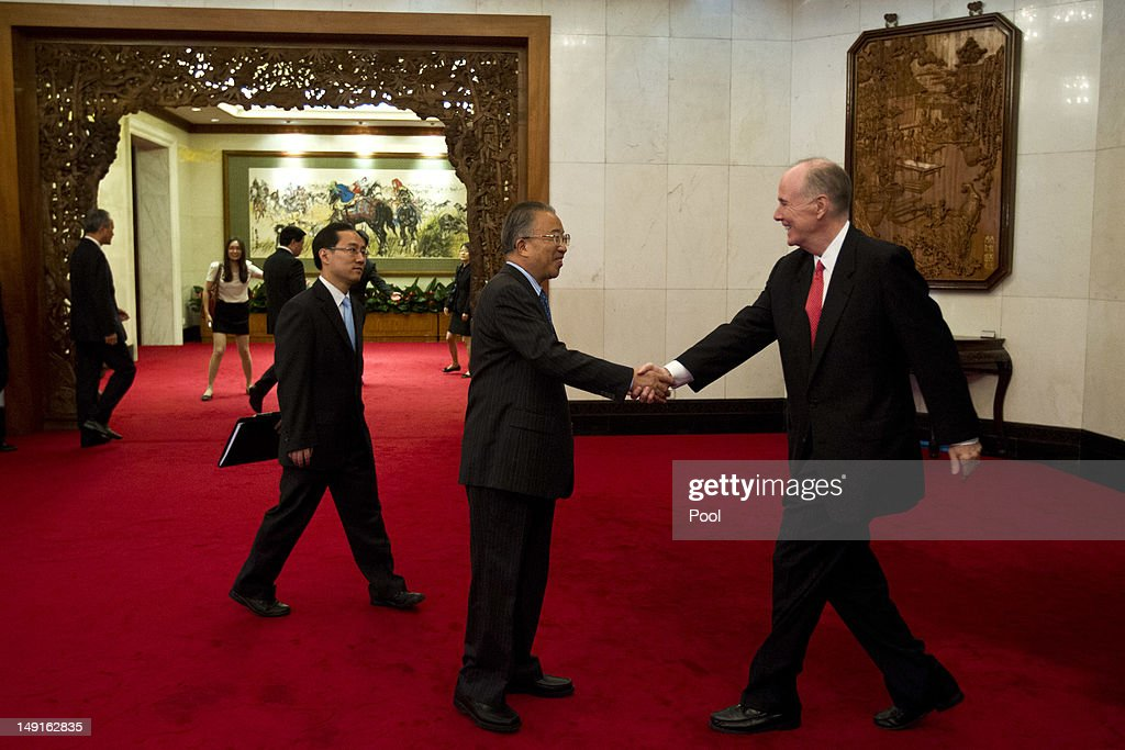 U.S. National Security Adviser Tom Donilon (R), shakes hands with Chinese State Councilor Dai Bingguo during their meeting at the Diaoyutai State Guesthouse on July 24, 2012 in Beijing, China. The two are expected to discuss a range of international issues, including Syria, Iran and N. Korea.