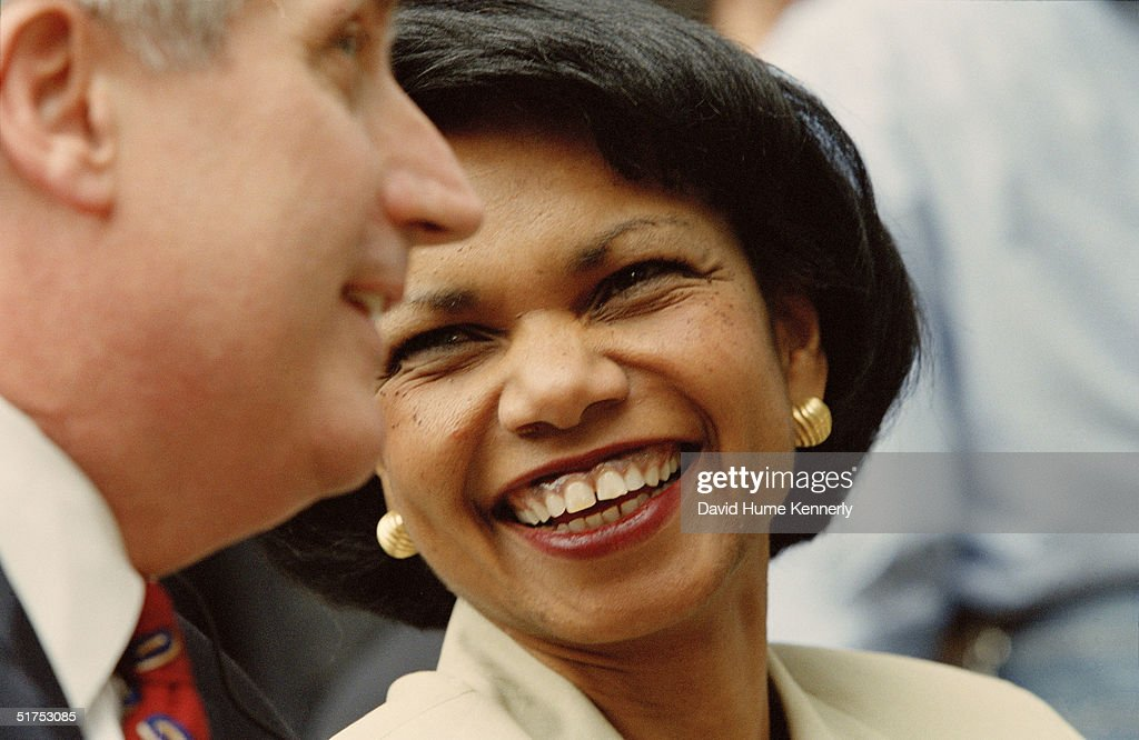 U.S. National Security Advisor Condoleezza Rice (C) talks to White House Chief of Staff Andy Card during a joint press conference with President George W. Bush and Spain's Prime Minister Jose Maria Aznar Lopez at the Moncloa Palace September 19, 2001 in Madrid, Spain.
