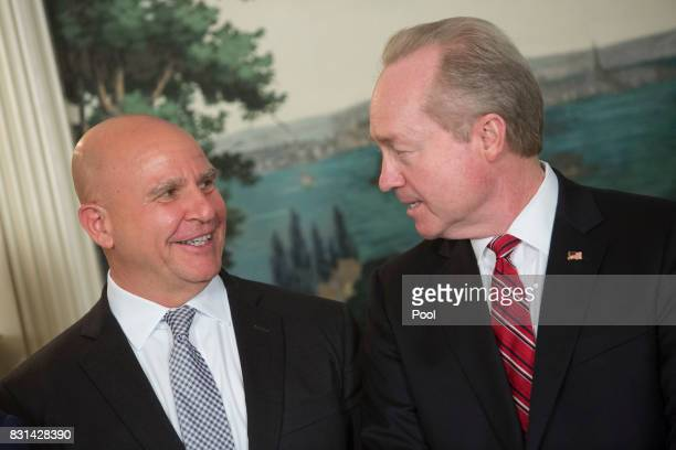 National Security Advisor HR McMaster speaks with Dr Thomas A Kennedy Chairman and Chief Executive Officer for Raytheon Company at the signing of a...