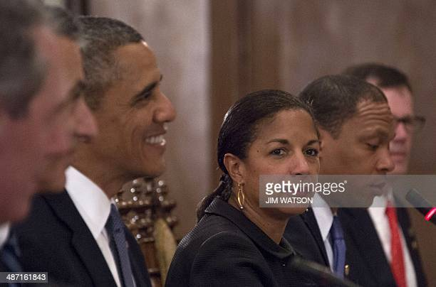 US National Security Advisor Susan Rice looks on alongside US President Barack Obama during a bilateral meeting with Philippines President Benigo...