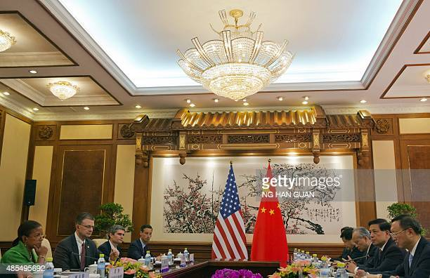US National Security Advisor Susan Rice takes part in talks with Chinese State Councilor Yang Jiechi during their meeting at the Diaoyutai State...