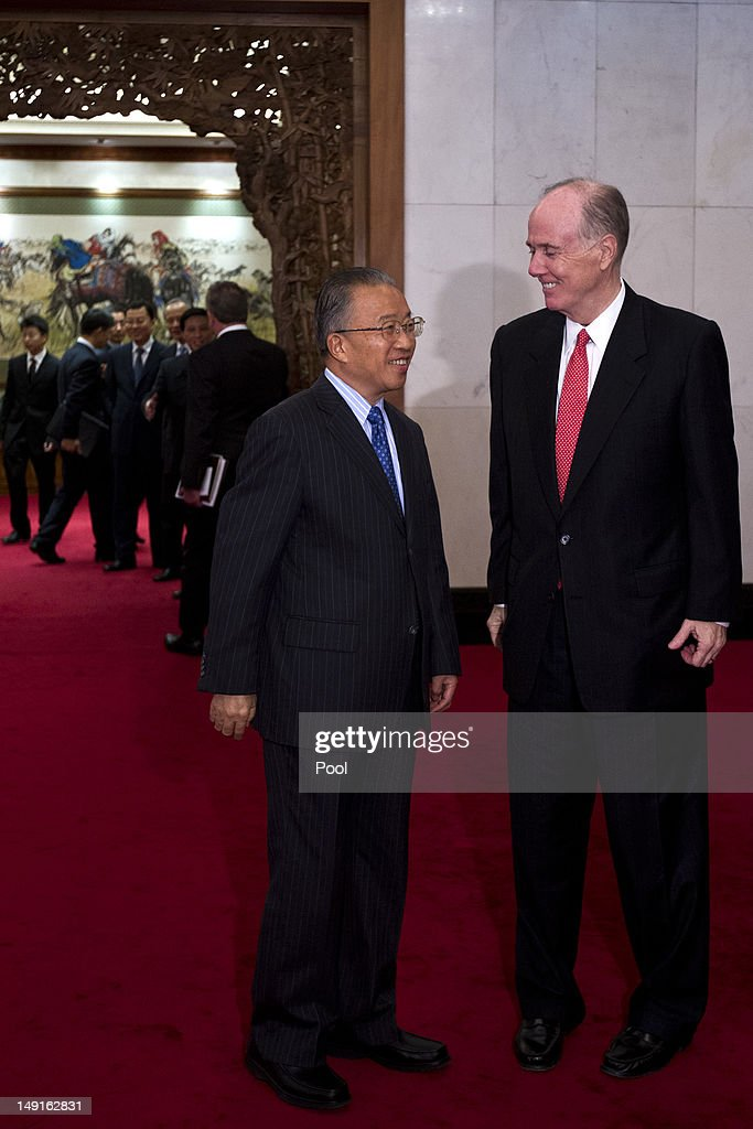 U.S. National Security Advisor Tom Donilon (R) and Chinese State Councilor Dai Bingguo (L), stand together after hand-shaking during their meeting at the Diaoyutai State Guesthouse on July 24, 2012 in Beijing, China. The two are expected to discuss a range of international issues, including Syria, Iran and N. Korea.