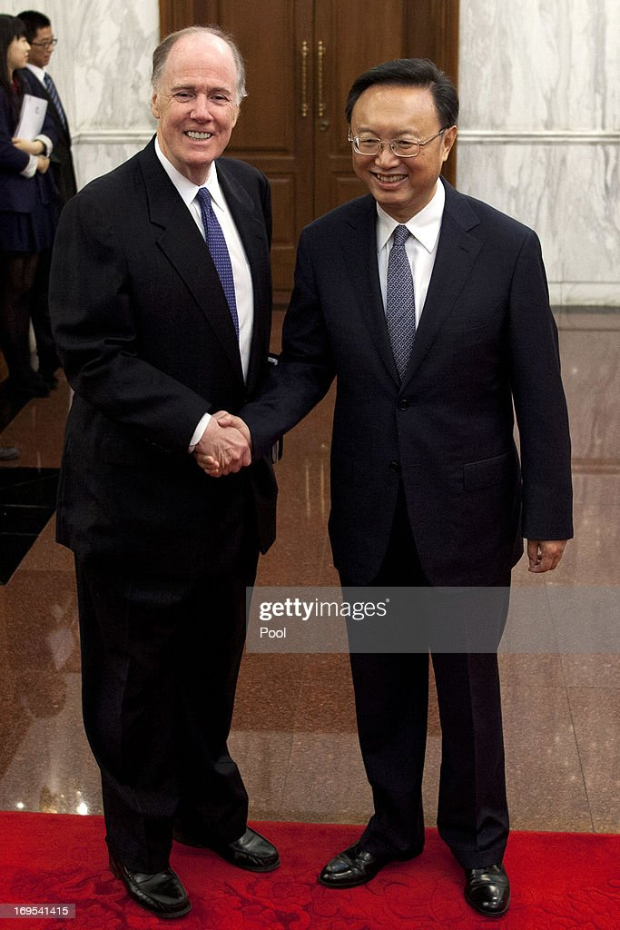 U.S. National Security Advisor Tom Donilon and Chinese State Councilor <a gi-track='captionPersonalityLinkClicked' href=/galleries/search?phrase=Yang+Jiechi&family=editorial&specificpeople=555098 ng-click='$event.stopPropagation()'>Yang Jiechi</a> shake hands before their meeting at Diaoyutai State Guesthouse on May 27, 2013 in Beijing, China.