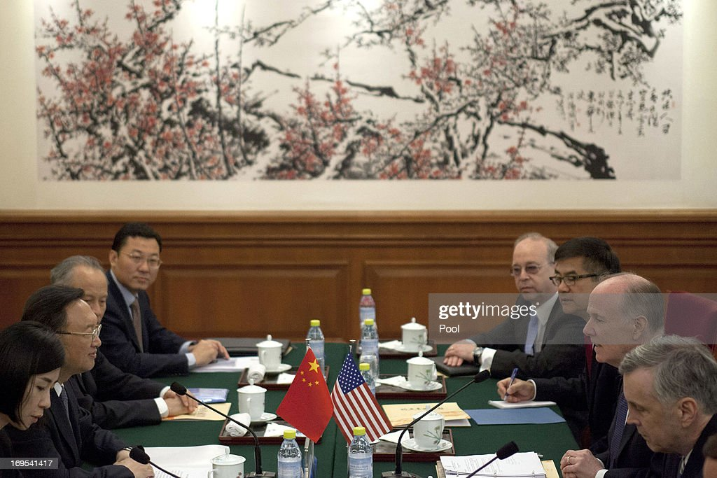 U.S. National Security Advisor Tom Donilon (2nd R) and Chinese State Councilor <a gi-track='captionPersonalityLinkClicked' href=/galleries/search?phrase=Yang+Jiechi&family=editorial&specificpeople=555098 ng-click='$event.stopPropagation()'>Yang Jiechi</a> (2nd L) talk during their meeting at Diaoyutai State Guesthouse on May 27, 2013 in Beijing, China.
