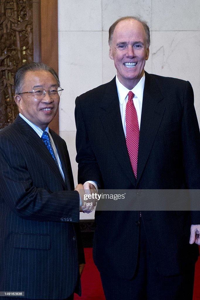 U.S. National Security Advisor Tom Donilon (R) shakes hands with Chinese State Councilor Dai Bingguo during their meeting at the Diaoyutai State Guesthouse on July 24, 2012 in Beijing, China. The two are expected to discuss a range of international issues, including Syria, Iran and N. Korea.