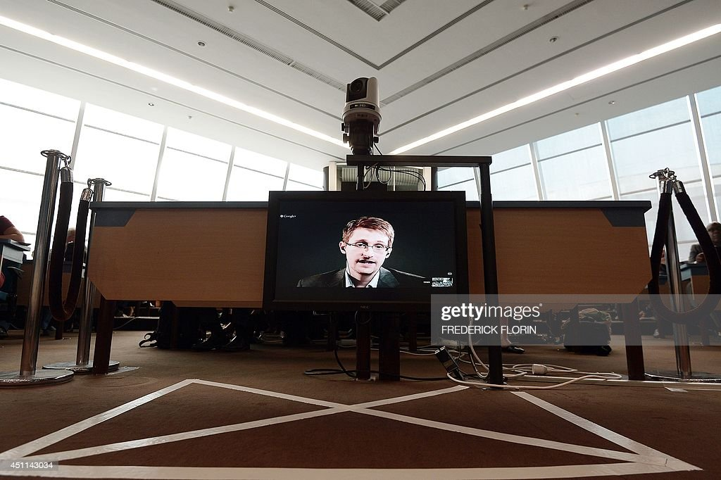 US National Security Agency whistleblower Edward Snowden speaks to European officials via videoconference during a parliamentary hearing on improving...