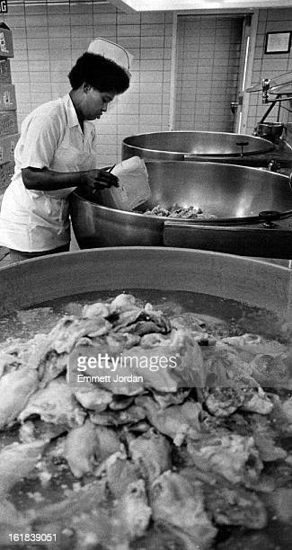 JUN 29 1983 National Sports Festival Dorothy Spanks empties part of the 670 lbs of chicken breasts into vats to be cooked