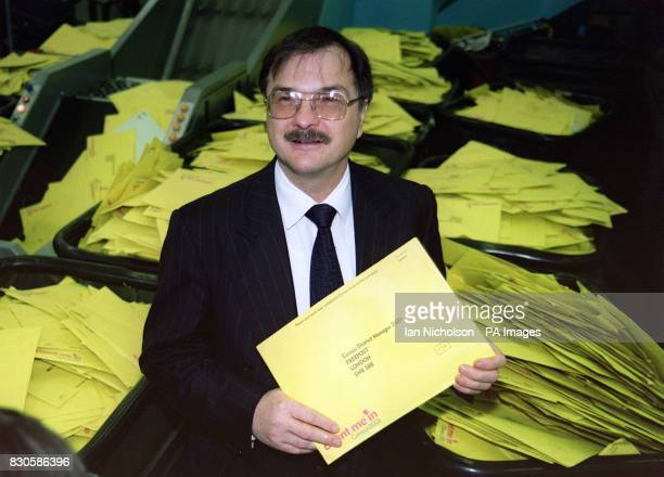 National Statistician Len Cook surveys the scene at the South London Mail Centre as a mountain of returned Census forms await processing 45 million...