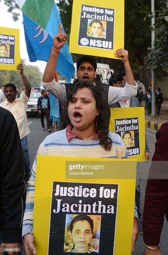 National Students Union of India activists shout slogans as they march to the British High Commission in support of Indian-born nurse <a gi-track='captionPersonalityLinkClicked' href=/galleries/search?phrase=Jacintha+Saldanha&family=editorial&specificpeople=10060250 ng-click='$event.stopPropagation()'>Jacintha Saldanha</a>, who was found dead after being hoaxed by an Australian radio show trying to reach Prince William's wife in London, during a protest in New Delhi on December 15, 2012. The body of the Indian-born nurse who was found hanged last week after taking a royal hoax call at a London hospital will arrive in India December 16, a police official said December 15. AFP PHOTO/RAVEENDRAN
