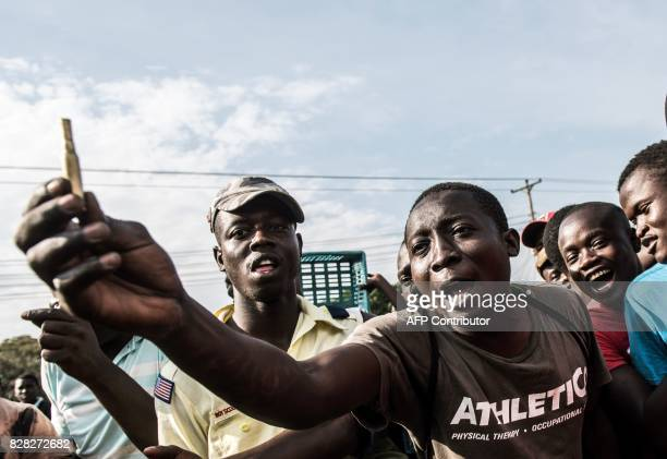 National Super Alliance supporters hold and show bullet casings which were allegedly fired by Kenyan police officials during a demonstration at...