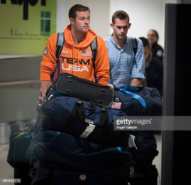 National Swimming Team members Jack Conger and Gunnar Bentz are escorted through the International terminal at Miami International Airport upon their...
