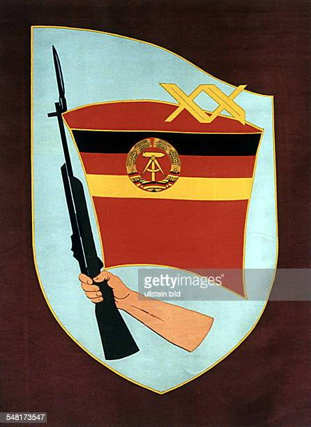 National symbols of the GDR Symbolic depiction of the Ministry for State Security flag with the GDR's coat of arms and hand holding a bayonet about...