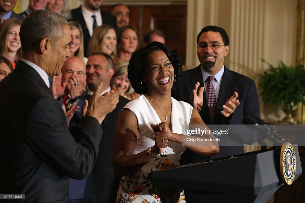 National Teacher of the Year Jahana Hayes (2nd R) of John F. Kennedy High School in Waterbury, CT, has a hard time controlling her excitement after taking the stage with U.S. President <a gi-track='captionPersonalityLinkClicked' href=/galleries/search?phrase=Barack+Obama&family=editorial&specificpeople=203260 ng-click='$event.stopPropagation()'>Barack Obama</a> (C), Education Secretary John King (R) and her fellow state teachers of the year during a ceremony in the East Room of the White House May 3, 2016 in Washington, DC. Obama talked about the influence and importance that each classroom instructor has on the lives of their students while honoring the teachers from all 50 states and U.S. territories.
