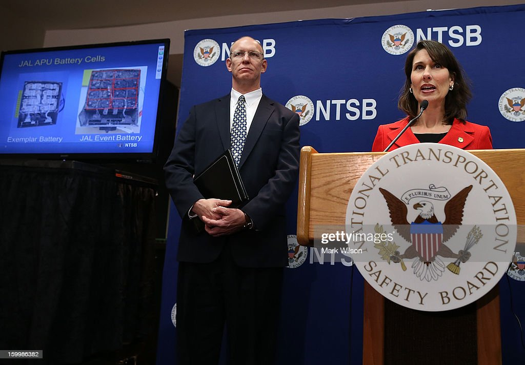 National Transportation Safety Board Chairman Deborah A.P. Hersman (R), speaks while John DeLisi, Deputy Director, NTSB Office of Aviation Safety, listens during a briefing a the NTSB headquaters on January 24, 2013 in Washington, DC. The NTSB held a news conference to discuss the batteries that caused the January 7, fire aboard a Japan Airlines (JAL) Boeing 787 at Logan International Airport in Boston.