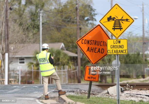 A National Transportation Safety Board Investigator stands on Wednesday March 8 2017 at the Main Street railroad crossing in Biloxi Miss On Tuesday...