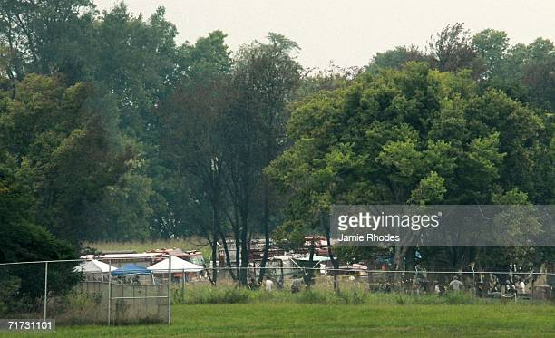 National Transportation Safety Board investigators work in a makeshift camp surrounding the crash site of Comair Flight 5191 August 28 2006 in...