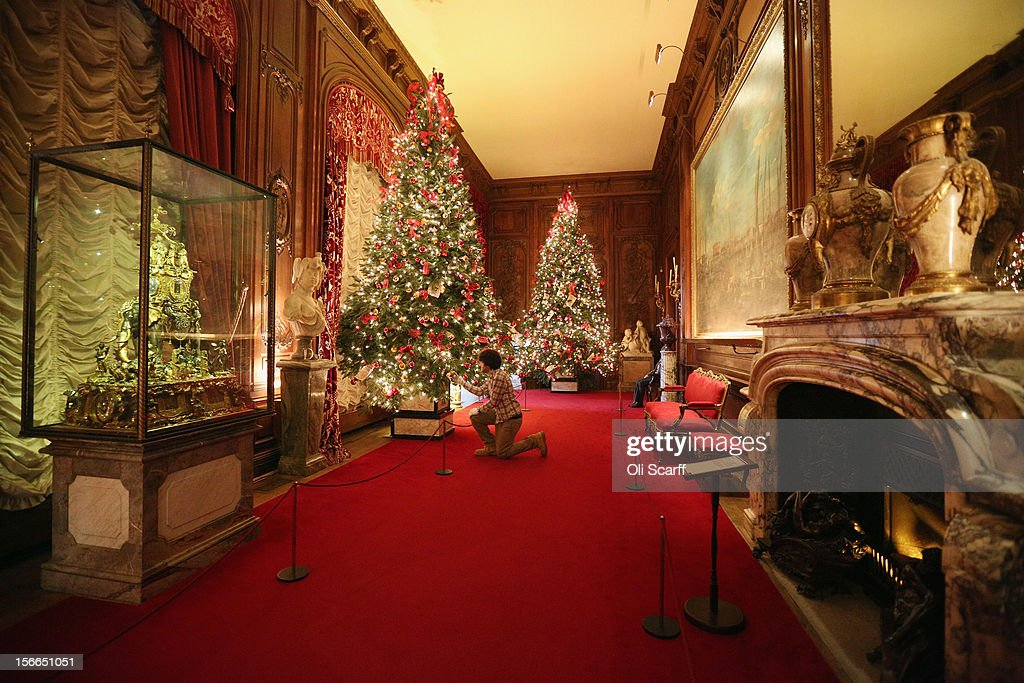 A National Trust employee adjusts the Christmas decorations in the East Gallery of Waddesdon Manor on November 16, 2012 in Aylesbury, England. The East Wing and Bachelor's Wing of Waddesdon Manor have been elaborately decorated for Christmas in the theme of English traditions and literature. The light-artist Bruce Munro has also created two installations in the grounds of the manor. The Christmas decorations at Waddesdon Manor are open to the general public until January 1, 2013.
