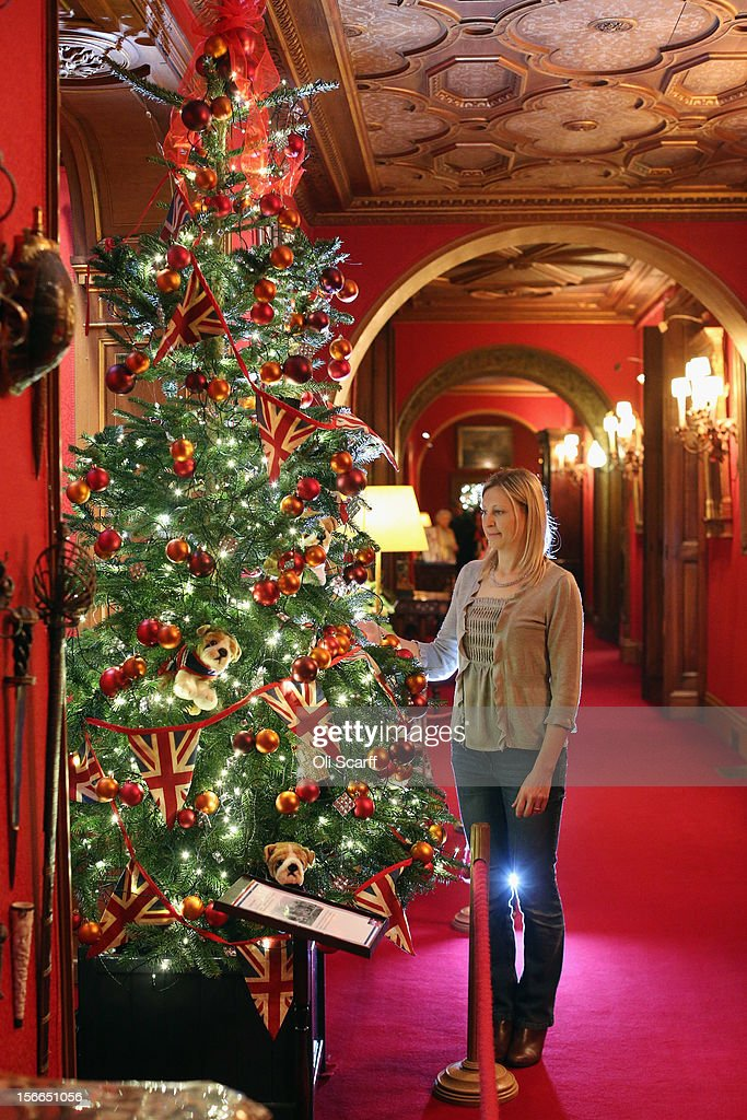 A National Trust employee adjusts the Christmas decorations in the Armoury Corridor of Waddesdon Manor on November 16, 2012 in Aylesbury, England. The East Wing and Bachelor's Wing of Waddesdon Manor have been elaborately decorated for Christmas in the theme of English traditions and literature. The light-artist Bruce Munro has also created two installations in the grounds of the manor. The Christmas decorations at Waddesdon Manor are open to the general public until January 1, 2013.