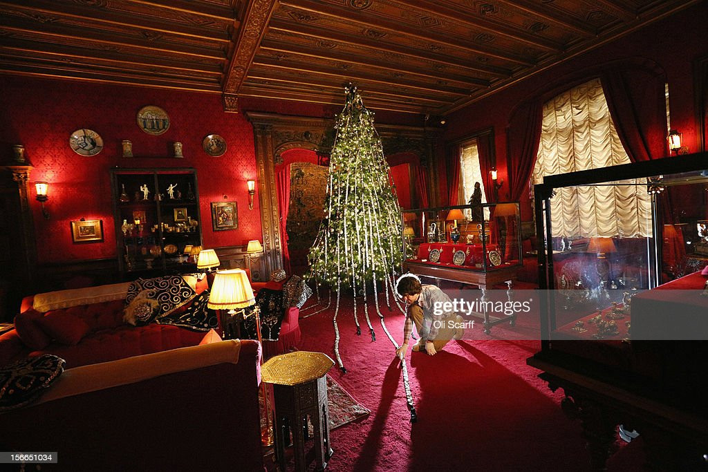 A National Trust employee adjusts the Christmas decorations on a 'Pearly Kings and Queens' theme in the Smoking Room of Waddesdon Manor on November 16, 2012 in Aylesbury, England. The East Wing and Bachelor's Wing of Waddesdon Manor have been elaborately decorated for Christmas in the theme of English traditions and literature. The light-artist Bruce Munro has also created two installations in the grounds of the manor. The Christmas decorations at Waddesdon Manor are open to the general public until January 1, 2013.