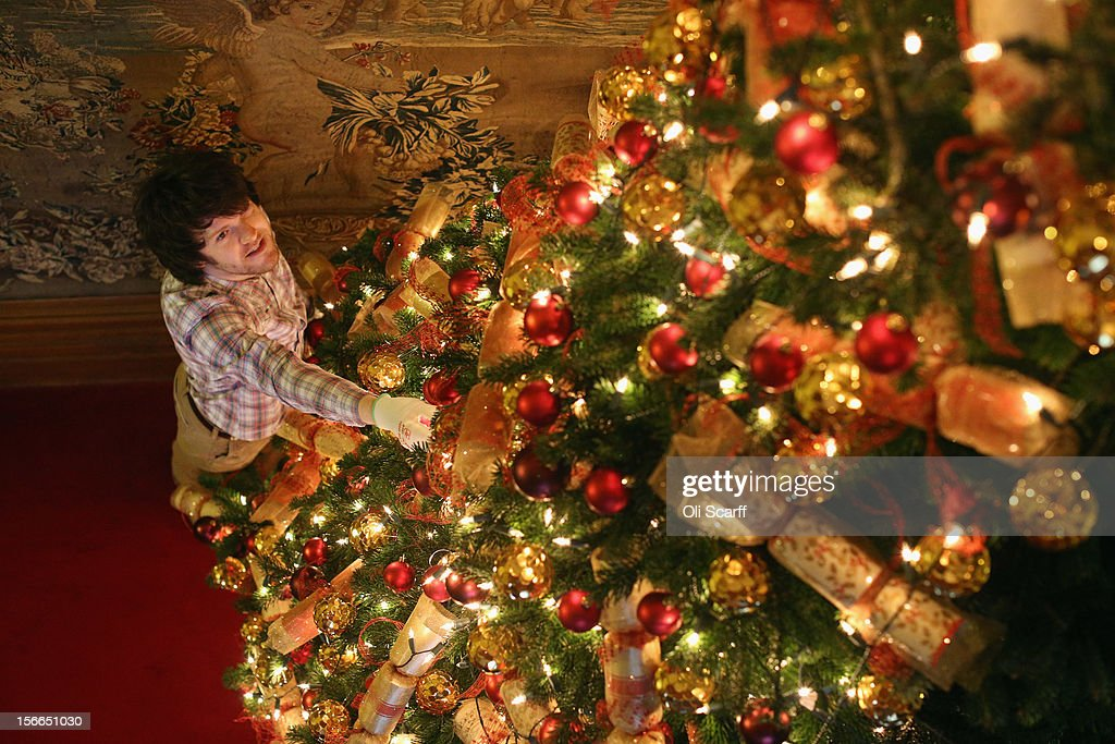 A National Trust employee adjusts the Christmas decorations on the tree in the Bedroom Corridor of Waddesdon Manor on November 16, 2012 in Aylesbury, England. The East Wing and Bachelor's Wing of Waddesdon Manor have been elaborately decorated for Christmas in the theme of English traditions and literature. The light-artist Bruce Munro has also created two installations in the grounds of the manor. The Christmas decorations at Waddesdon Manor are open to the general public until January 1, 2013.