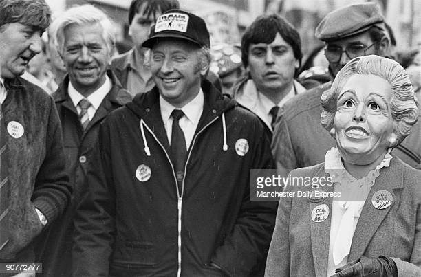 National Union of Mineworkers� General Secretary Arthur Scargill amused by a supporter wearing a Margaret Thatcher mask during a demonstration...