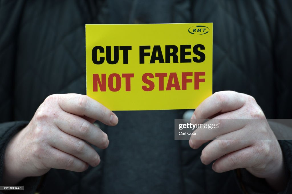A National Union of Rail, Maritime and Transport Workers (RMT) member take part in a protest against rail fare increases on August 15, 2017 at King's Cross Station in London, England. Protests have been planned at numerous stations throughout the U.K today as a fare increase of 3.6% in January 2018 was announced.
