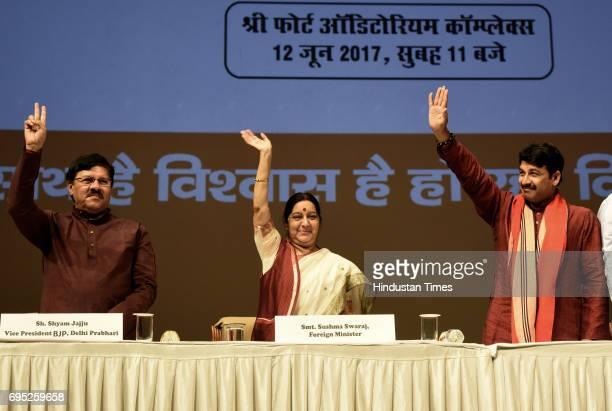 National Vice President and Delhi BJP Incharge Shyam Jaju Union External Affairs Minister Sushma Swaraj Delhi BJP President Manoj Tiwari wave to...