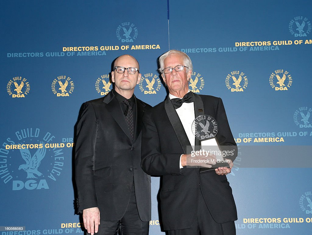 National Vice President <a gi-track='captionPersonalityLinkClicked' href=/galleries/search?phrase=Steven+Soderbergh&family=editorial&specificpeople=215049 ng-click='$event.stopPropagation()'>Steven Soderbergh</a> (L) and director <a gi-track='captionPersonalityLinkClicked' href=/galleries/search?phrase=Michael+Apted&family=editorial&specificpeople=211167 ng-click='$event.stopPropagation()'>Michael Apted</a>, winner of the Robert B.Aldrich Award, pose in the press room during the 65th Annual Directors Guild Of America Awards at Ray Dolby Ballroom at Hollywood & Highland on February 2, 2013 in Los Angeles, California.