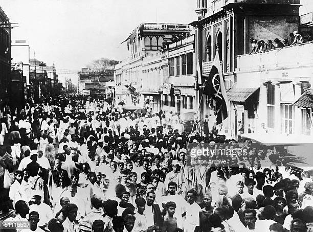 National volunteers supporters of Mahatma Gandhi march through the streets of Madras carrying the banner of home rule 1930