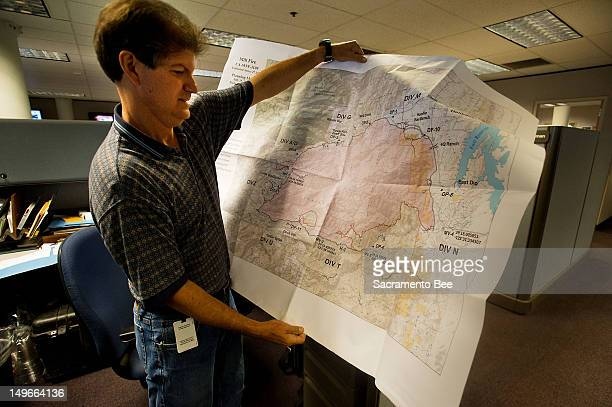 National Weather Service Meteorologist Mike Smith examines a map in his office in Sacramento California July 25 2012 Meteorologists play a key role...