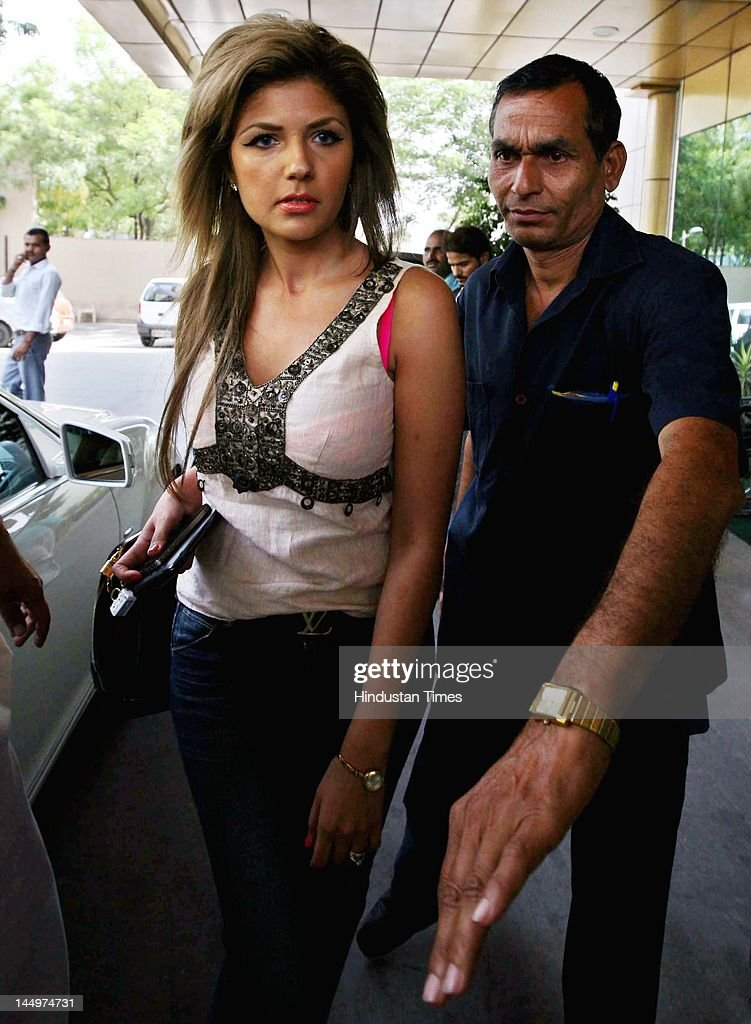 US national Zohail Hamid, fiancé of Mumbai-based businessman Sahil Peerzada who was discharged from the hospital is escorted to a car on May 21, 2012 in New Delhi, India. Peerzada was allegedly assaulted by Royal Challengers Bangalore cricketer Luke Pomersbach after he objected the cricketer attempts to molest his fiancé Zohal Hamid. The cricketer was later arrested and released on bail.
