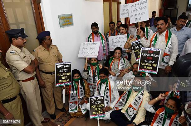 Nationalist Congress Party Corporators protesting outside BMC Standing Committee Chairman's room wearing face mask against the polluting Deonar...