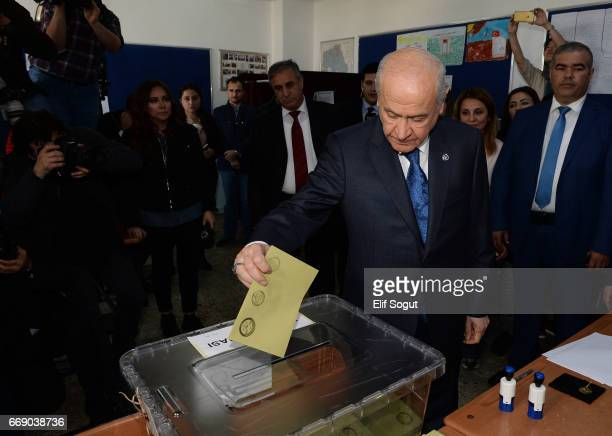 Nationalist Movement Party leader Devlet Bahceli casts his ballots at a polling station during a referendum in Ankara April 16 2017 Turkey Millions...