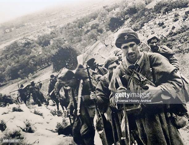 Nationalist soldiers pass through hills in Spain during the Spanish Civil War