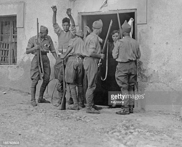 Nationalist troops search a farmer and his wife for weapons after their capture of the Basque town of Irun during the Spanish Civil War Spain 6th...